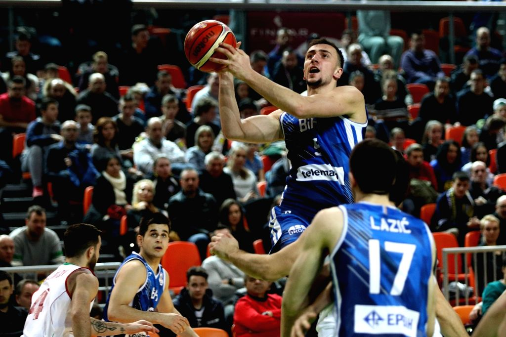 ZENICA, Feb. 25, 2019 - Edin Atic (Top) of Bosnia and Herzegovina competes during the 2019 FIBA Basketball World Cup 2019 European Qualifiers between Bosnia and Herzegovina and Bulgaria in Zenica, ...