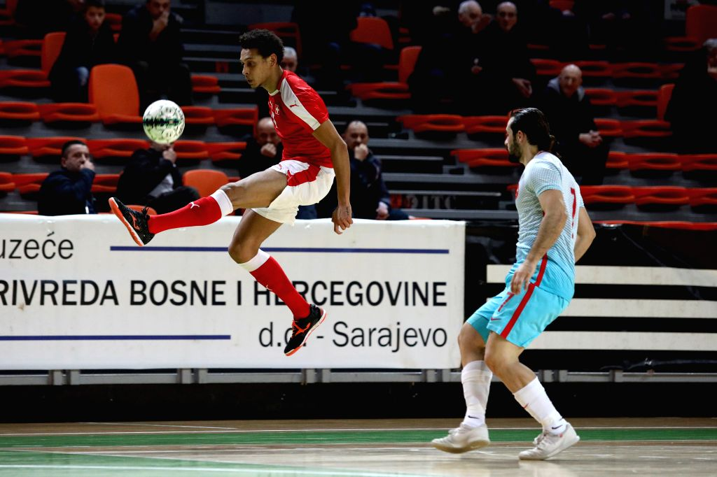 ZENICA, Jan. 31, 2019 - Gabriel Buckson (L) of Switzerland competes during the Group F Second Preliminary Round Match of qualification for FIFA Futsal World Championship 2020 between Switzerland and ...