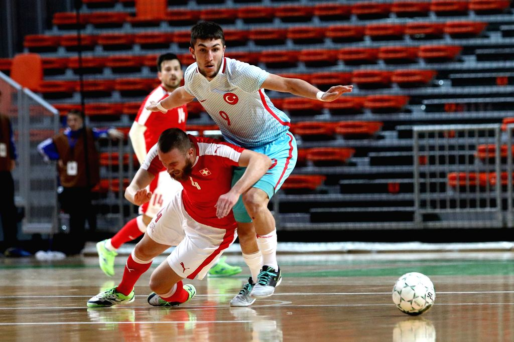ZENICA, Jan. 31, 2019 - Muhammet Furkan Ozkan of Turkey (R) competes during the Group F Second Preliminary Round Match of qualification for FIFA Futsal World Championship 2020 between Switzerland and ...