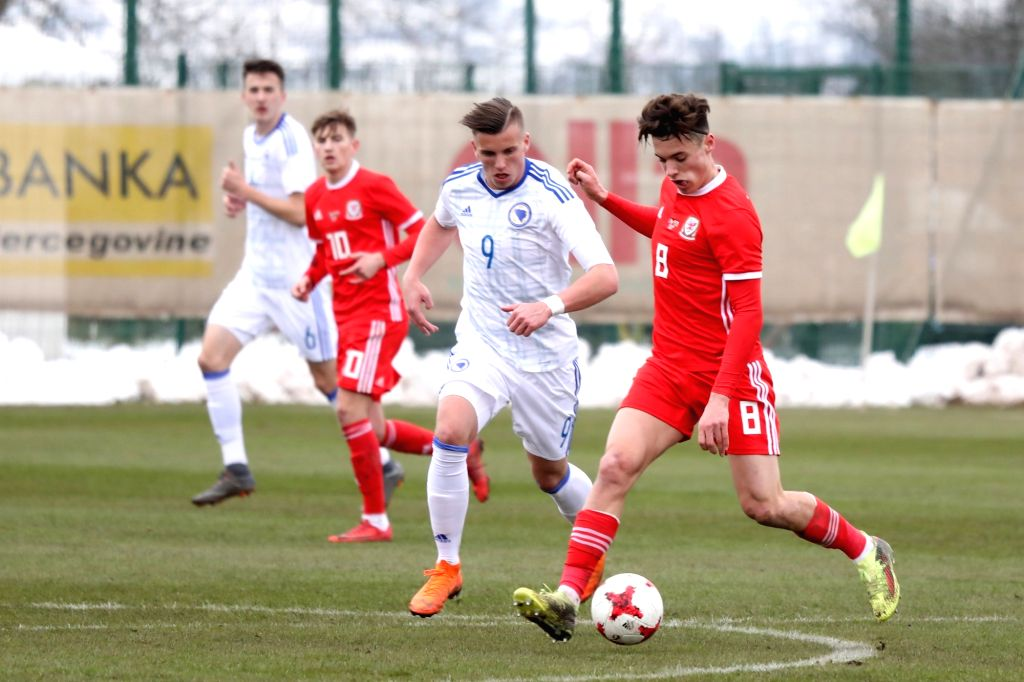 ZENICA, March 24, 2018 - Jack Evans (1st R) of Wales vies with Ermedin Demirovic (2nd R) of Bosnia and Herzegovina (BiH) during the UEFA 2019 U21 EURO qualifying Group 8 match between BiH and Wales ...