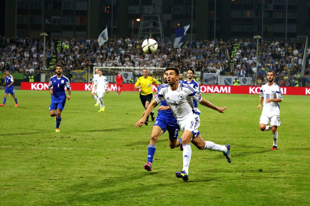 Vedad Ibisevic of Bosnia and Herzegovina (C) vies for the ball during the Euro 2016 qualifying soccer match against Cyprus in Zenica, Bosnia and Herzegovina, Sept. .