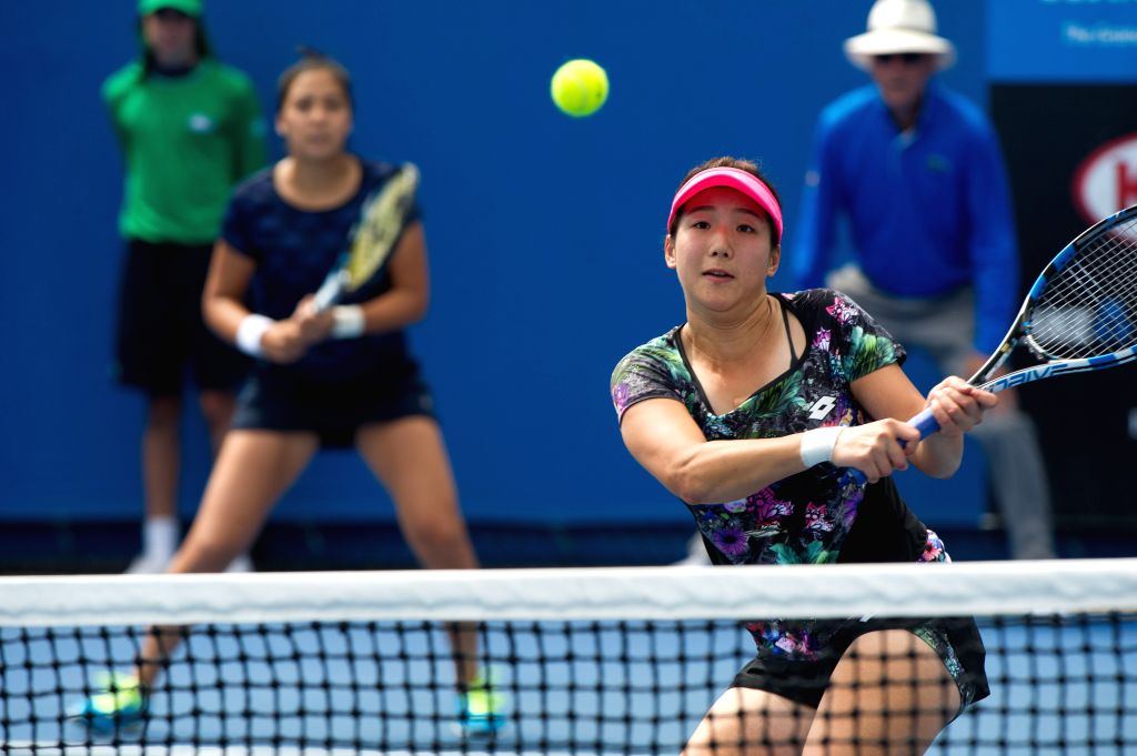 Zhang Kailin (Front) of China and Zarina Diyas of Kazakhstan compete during the first round match of women's doubles against Margarita Gasparyan and Alexandra ...