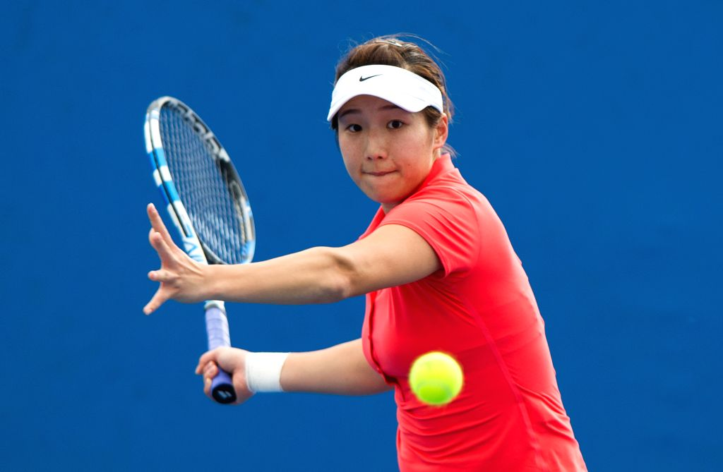 Zhang Kailin of China returns the ball to Jang Su Jeong of South Korea during the women's singles first round of Australian Open qualifying match at Melbourne ...