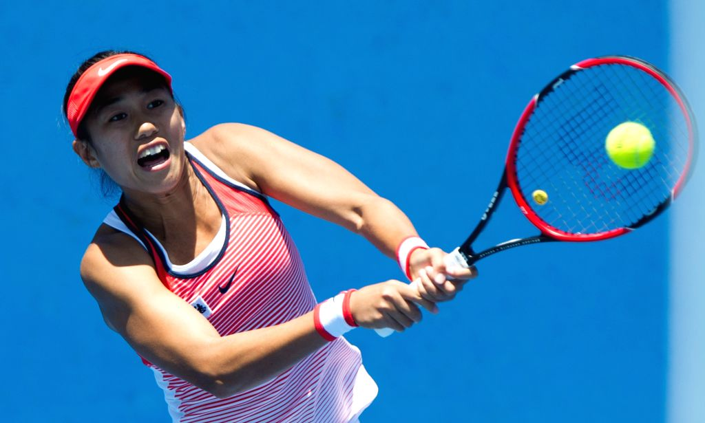 Zhang Shuai of China returns the ball during the women's singles final round of Australian Open qualifying match against Virginie Razzano of France at Melbourne ...