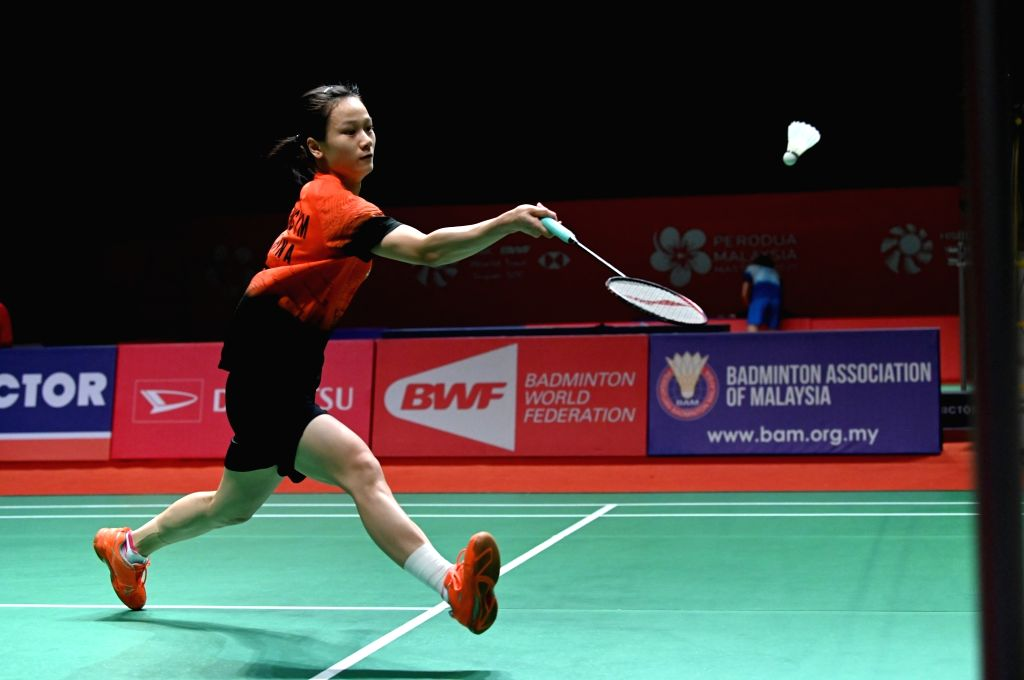 Zhang Yiman of China competes during the women's singles first round match against Tai Tzu Ying of Chinese Taipei at Malaysia Masters 2020 badminton tournament ...