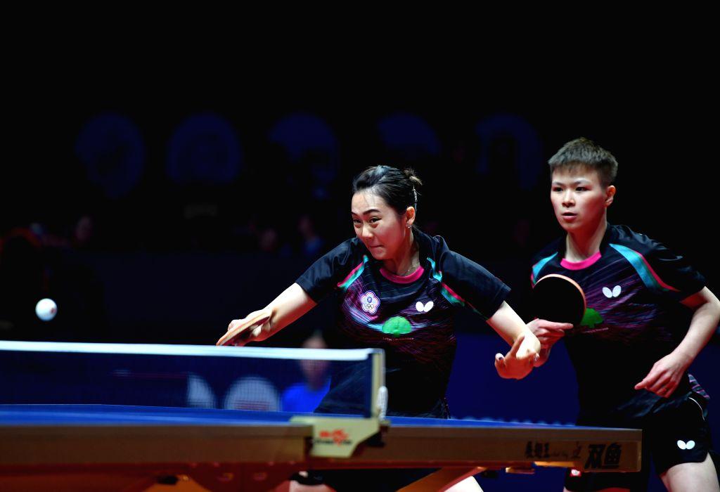 ZHENGZHOU, Dec. 12, 2019 - Chen Szu Yu/Cheng Hsien Tzu (L) of Chinese Taipei compete during the women's doubles quarterfinals between Chen Szu Yu/Cheng Hsien Tzu of Chinese Taipei and Hirano ...
