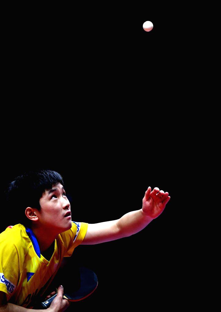 ZHENGZHOU, Dec. 13, 2019 - Harimoto Tomokazu of Japan serves during the men's singles quarterfinal against Xu Xin of China at the 2019 ITTF World Tour Grand Finals in Zhengzhou, central China's Henan ...
