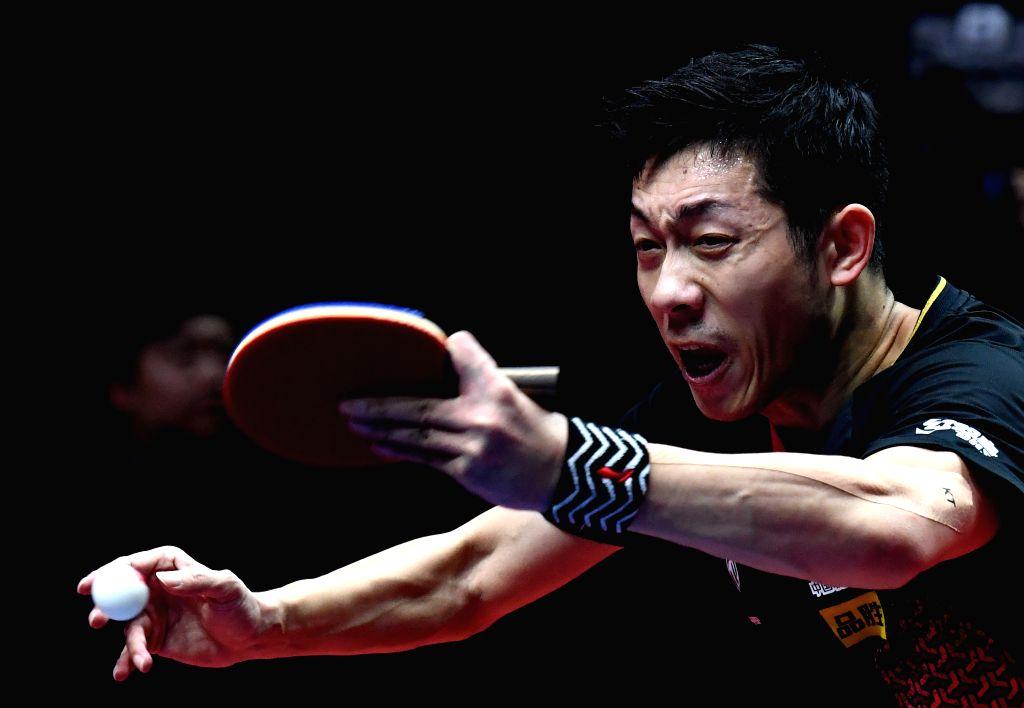 ZHENGZHOU, Dec. 13, 2019 - Xu Xin of China returns a shot during the men's singles quarterfinal against Harimoto Tomokazu of Japan at the 2019 ITTF World Tour Grand Finals in Zhengzhou, central ...