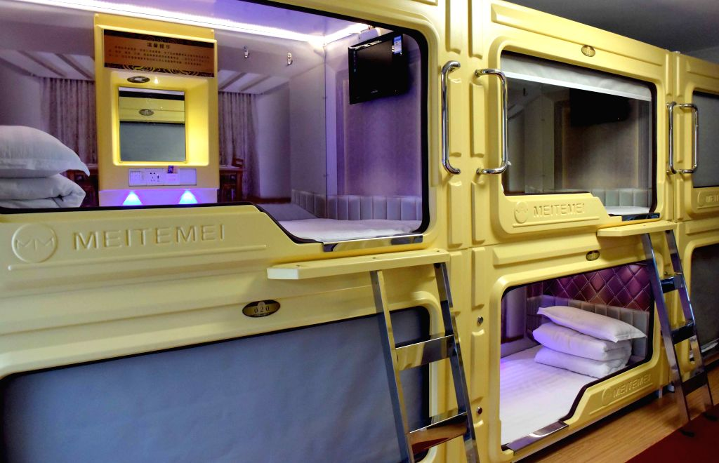 Cell units are seen in a capsule apartment in Zhengzhou, capital of central China's Henan Province, Jan. 15, 2015. In Zhengzhou, several capsule apartments with ..
