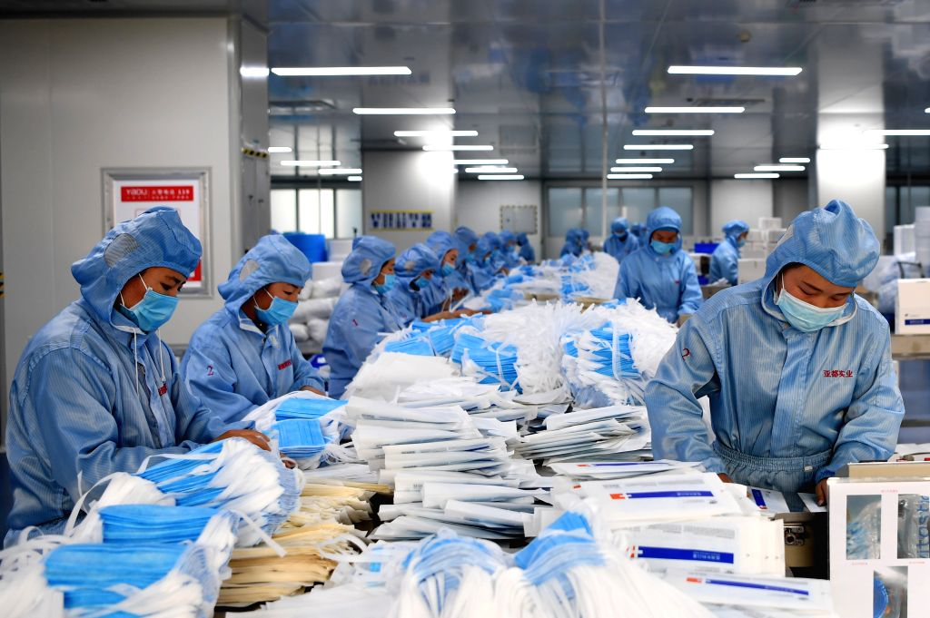 ZHENGZHOU, Jan. 28, 2020 (Xinhua) -- Workers make face masks at the workshop of a company in Changyuan, central China's Henan Province, Jan. 27, 2020. To help fight the outbreak of pneumonia caused by novel coronavirus, workers of 42 medical material