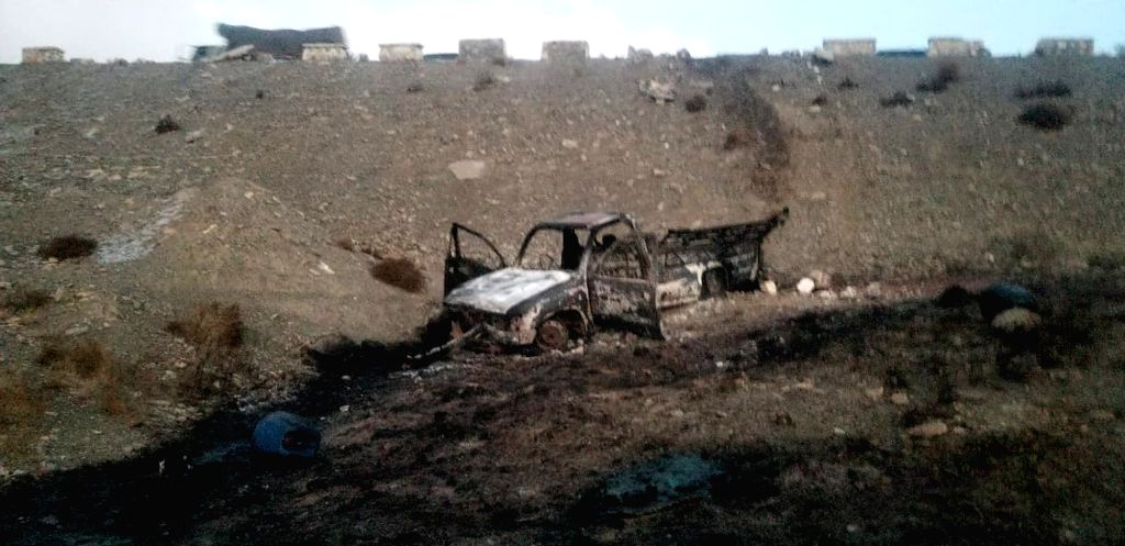 ZHOB, Dec. 13, 2019 - Photo taken with a mobile phone shows a burnt van at the accident site in Zhob, Pakistan's southwest province of Balochistan, Dec. 13, 2019. At least 15 people were killed and ...