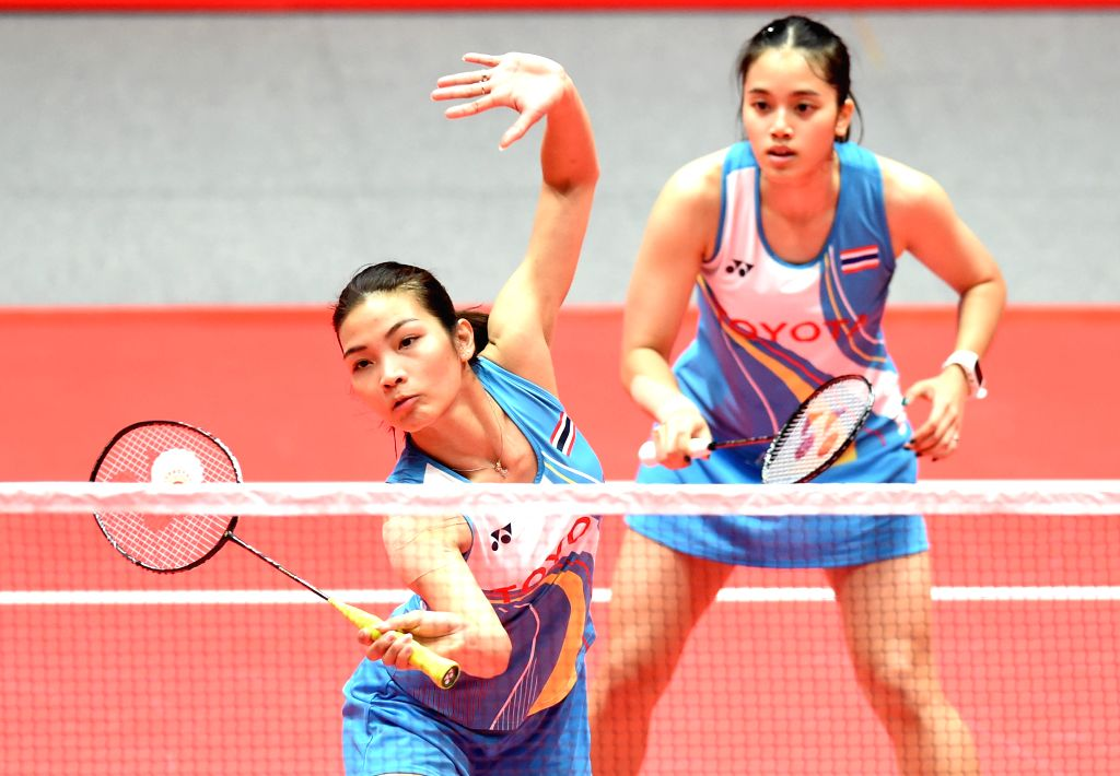 ZHONGGUO, Dec. 12, 2019 - Jongkolphan Kititharakul (L)/Rawinda Prajongjai of Thailand compete during the women's doubles group B match between Kim So Yeong /Kong Hee Yong of South Korea and ...