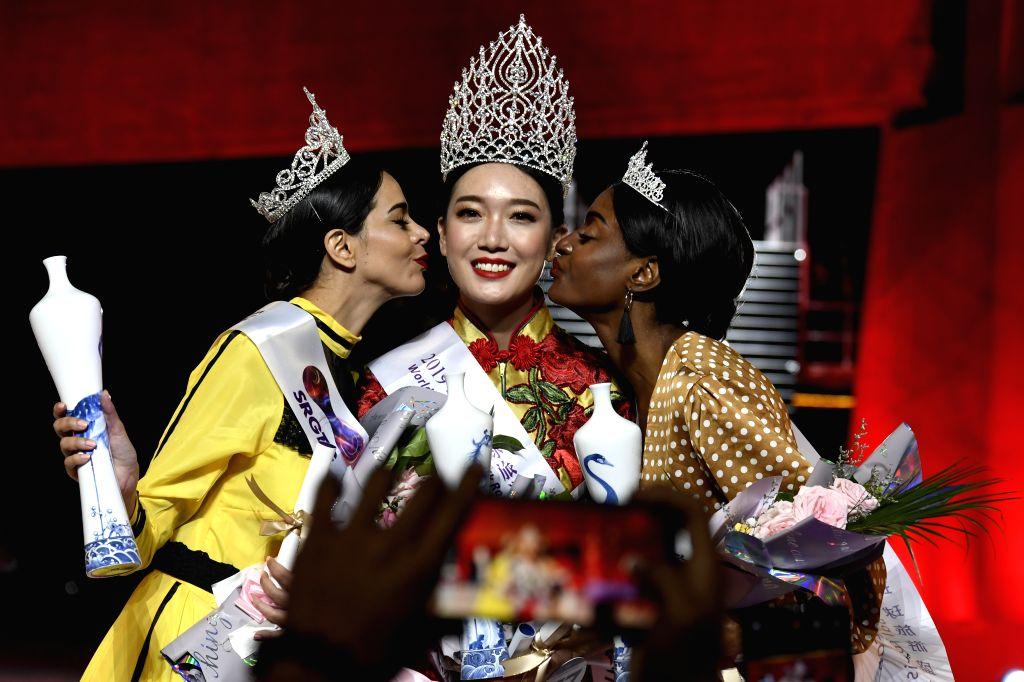 ZHONGWEI, Sept. 13, 2019 - Winner Zhu Wenrui (C) from China celebrates in the final of 2019 Silk Road Miss Tourism of the Globe in Zhongwei, northwest China's Ningxia Hui Autonomous Region, Sept. 12, ...