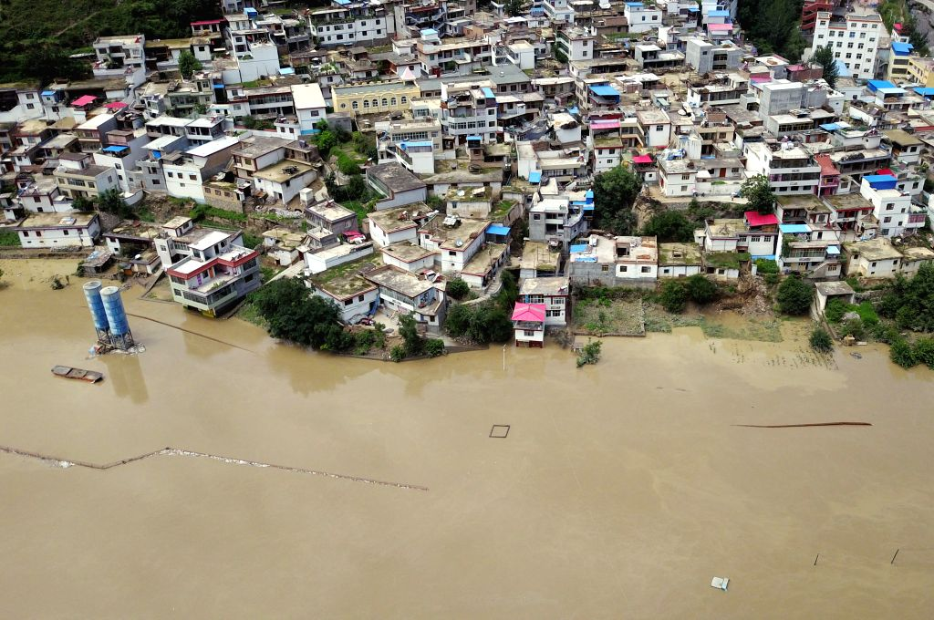 ZHOUQU, July 14, 2018 - Aerial photo taken on July 14, 2018 shows the flooded Nanyi Village and Naner Village in Nanyu Township of Zhouqu County, northwest China's Gansu Province. A landslide ...