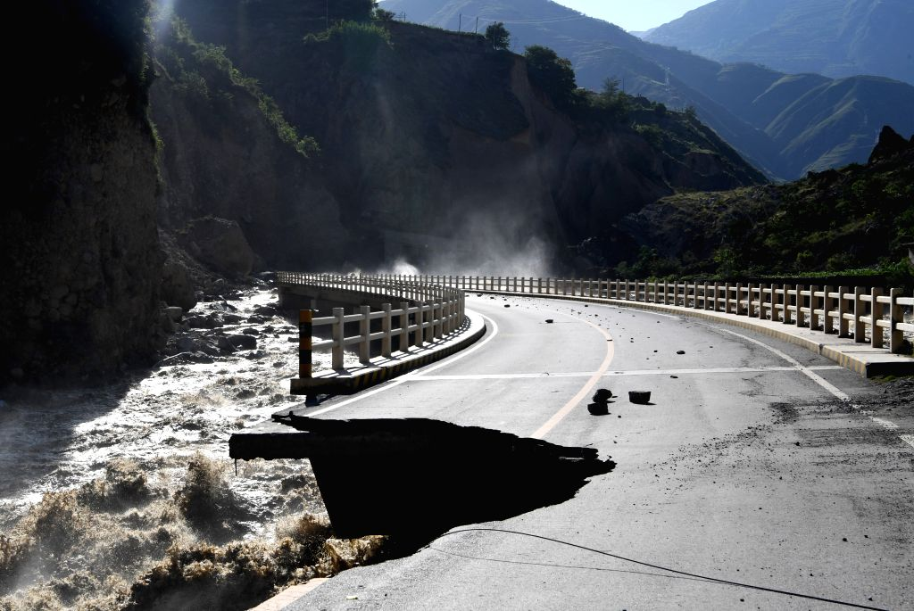 ZHOUQU, July 14, 2018 - Photo taken on July 13, 2018 shows a damaged road in Nanyu Township of Zhouqu County, northwest China's Gansu Province. A landslide occurred on Thursday at Nanyu Township of ...