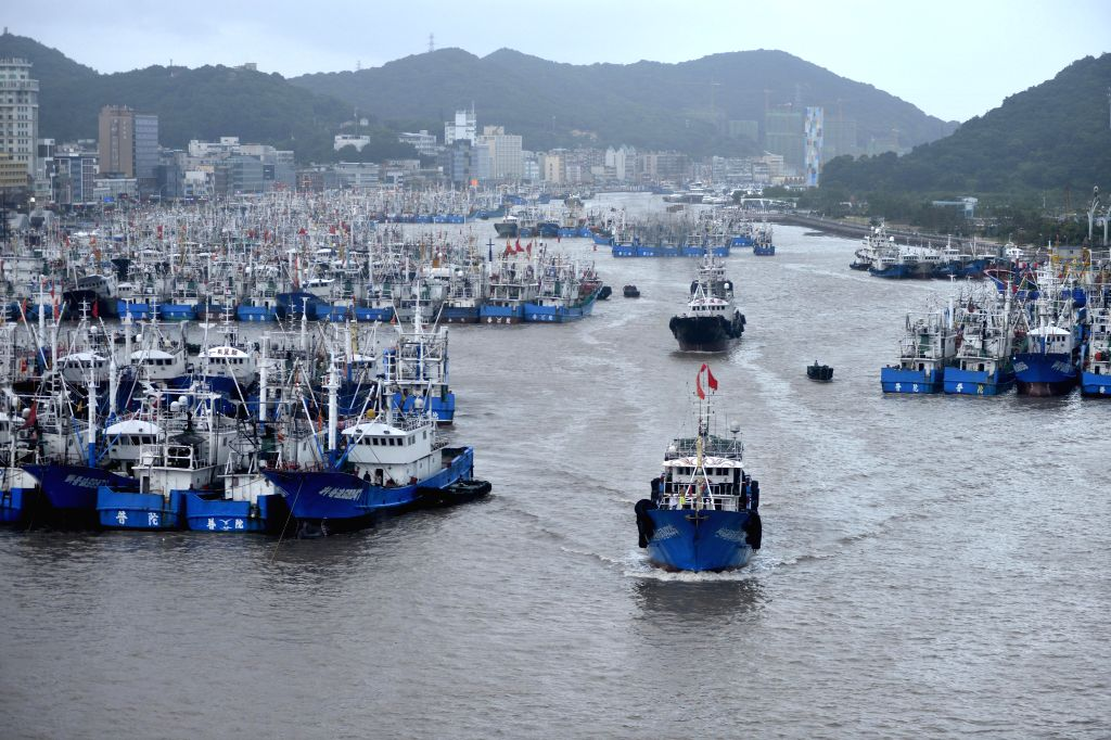 ZHOUSHAN, Aug. 8, 2019 (Xinhua) -- Photo taken on Aug. 8, 2019 shows ships returning to harbor in Zhoushan, east China's Zhejiang Province, Aug. 8, 2019. Provinces on the east coast of China have been busy getting prepared as Lekima, the ninth typhoo