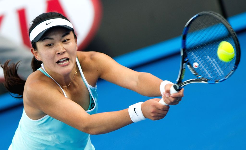 Zhu Lin of China returns the ball to Elena Vesnina of Russia during the women's singles first round of Australian Open qualifying match at Melbourne Park in ...