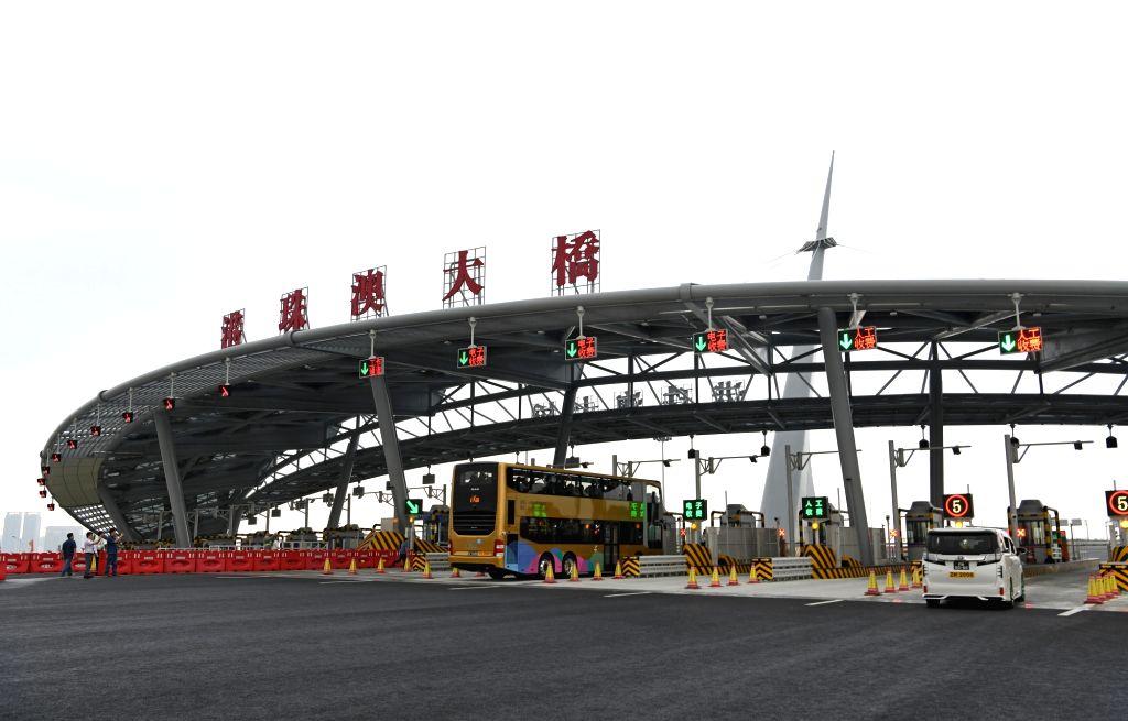 ZHUHAI, Oct. 24, 2018 - Cars from Zhuhai heading to Hong Kong run on the Hong Kong-Zhuhai-Macao Bridge, Oct. 24, 2018. The Hong Kong-Zhuhai-Macao bridge, the world's longest cross-sea bridge, opened ...