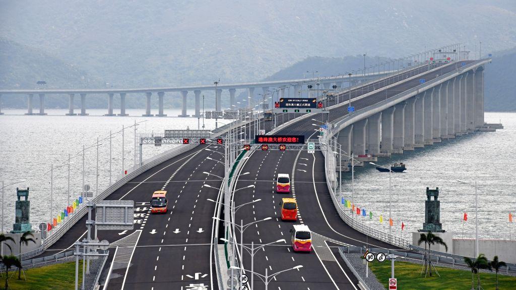 ZHUHAI, Oct. 24, 2018 - Cars run on the Hong Kong-Zhuhai-Macao Bridge, Oct. 24, 2018. The Hong Kong-Zhuhai-Macao bridge, the world's longest cross-sea bridge, opened to public traffic at 9 a.m. ...