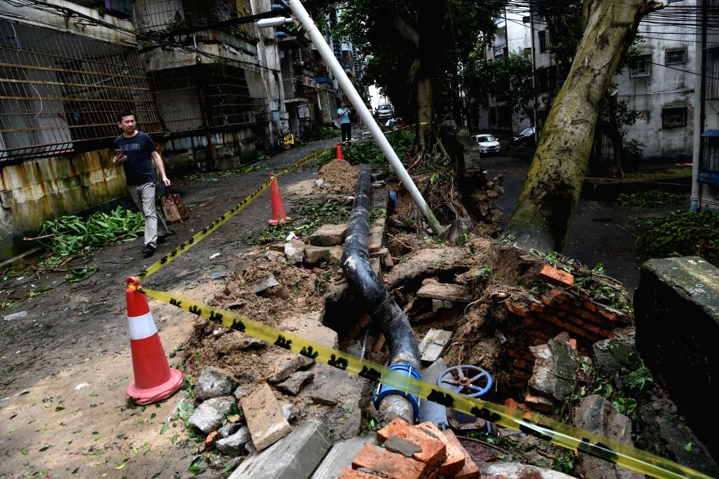ZHUHAI, Sept. 17, 2018 - A burst water pipe and a fallen tree are treated overnight near Jiuzhou Avenue in Zhuhai, south China's Guangdong Province, Sept. 17, 2018. The impact of Super Typhoon ...