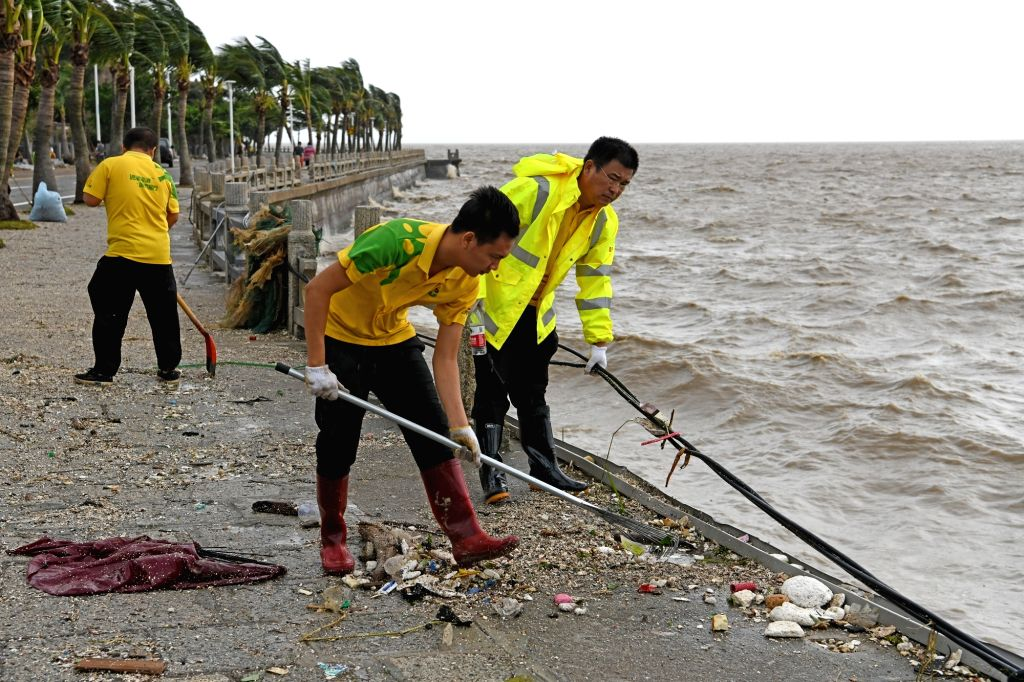 ZHUHAI, Sept. 17, 2018 - A company organizes its staff to help clear trash and gravel in Zhuhai, south China's Guangdong Province, Sept. 17, 2018. The impact of Super Typhoon Mangkhut on Zhuhai is ...