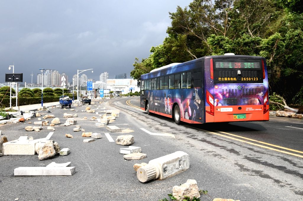 ZHUHAI, Sept. 17, 2018 - Lanes are cleared to resume public transportation at a road in Zhuhai, south China's Guangdong Province, Sept. 17, 2018. The impact of Super Typhoon Mangkhut on Zhuhai is ...