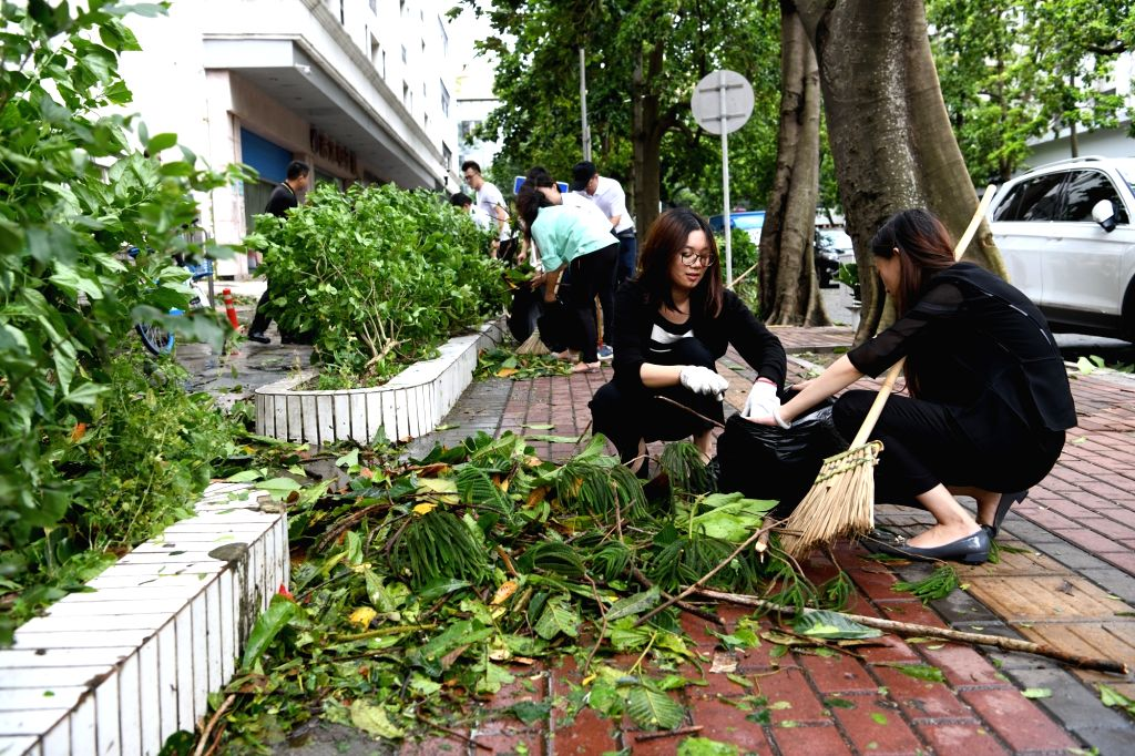 ZHUHAI, Sept. 17, 2018 - Staff clears the street on Jingle Road in Zhuhai, south China's Guangdong Province, Sept. 17, 2018. The impact of Super Typhoon Mangkhut on Zhuhai is gradually decreasing. ...