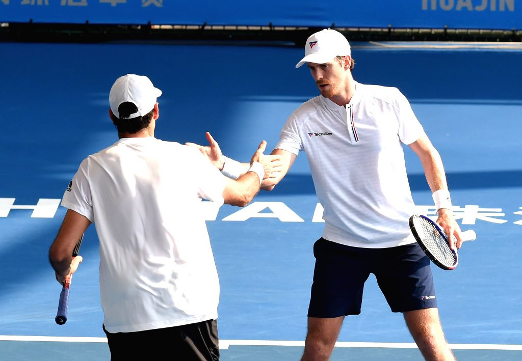 ZHUHAI, Sept. 25, 2019 - Marcus Daniell (R) of New Zealand/Philipp Oswald of Austria react during the men's doubles first round match between Wu Di/Zhang Zhizhen of China and Marcus Daniell of New ...