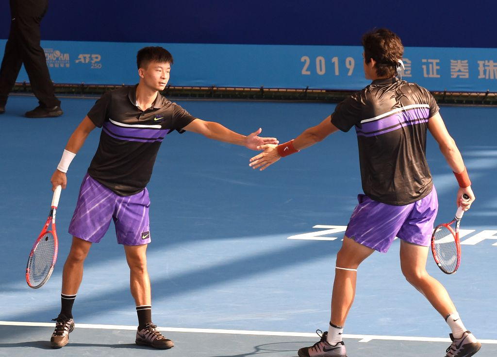ZHUHAI, Sept. 25, 2019 - Wu Di/Zhang Zhizhen (R) of China react during the men's doubles first round match between Wu Di/Zhang Zhizhen of China and Marcus Daniell of New Zealand/Philipp Oswald of ...