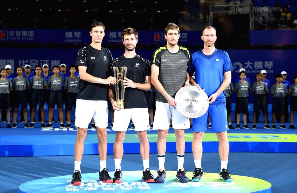 ZHUHAI, Sept. 29, 2019 - Sander Gille (2nd L)/Joran Vliegen (1st L) of Belgium and Matwe Middelkoop (1st R) of the Netherlands/Marcelo Demoliner of Brazil pose on the podium after the men's doubles ...