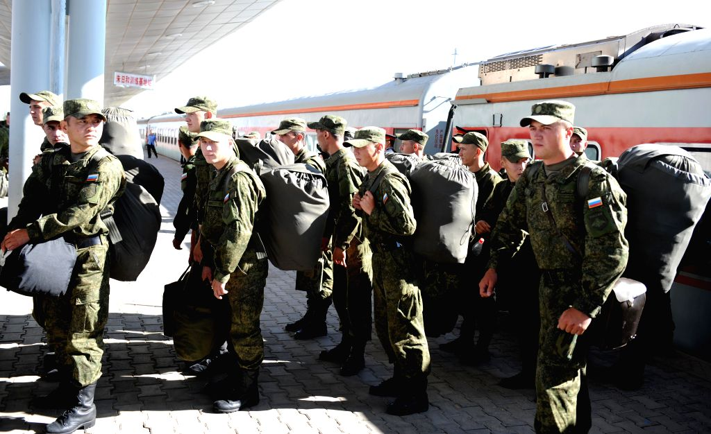 Russian soldiers arrive at the train station of the Zhurihe training base, north China's Inner Mongolia Autonomous Region, Aug. 16, 2014. The first Russian army ...