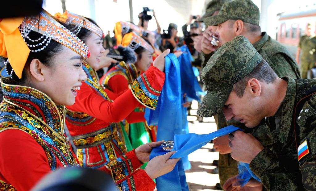 Russian soldiers are welcomed as they arrive at the train station of the Zhurihe training base, north China's Inner Mongolia Autonomous Region, Aug. 16, 2014. The ..