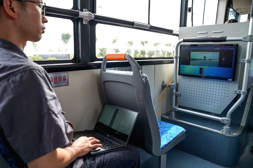 ZHUZHOU, Aug. 16, 2017 - A technician monitors a 12-meter-long electric smart bus on the bus during a road test in Zhuzhou, central China's Hunan Province, Aug. 15, 2017. Chinese rail maker CRRC ...