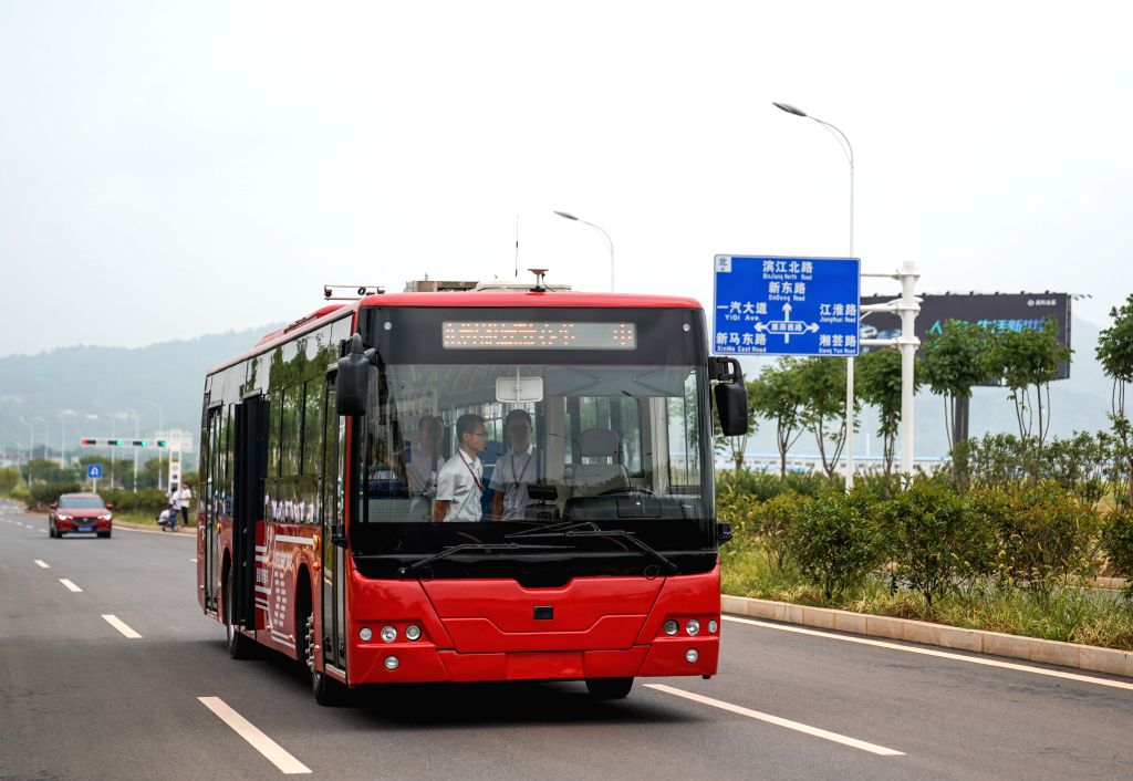 ZHUZHOU, Aug. 16, 2017 - Photo taken on Aug. 15, 2017 shows a 12-meter-long electric smart bus running on the road during a road test in Zhuzhou, central China's Hunan Province. Chinese rail maker ...
