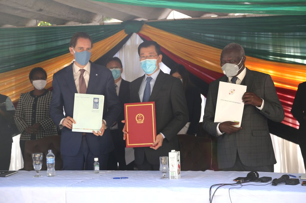 Zimbabwe's Minister of Local Government, Public Works and National Housing July Moyo (R, Front), Chinese Ambassador to Zimbabwe Guo Shaochun (C, Front), and the UNDP ...
