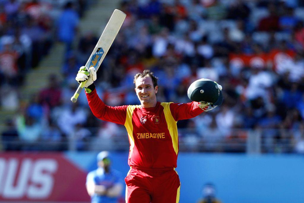 Zimbabwean cricketer Brendan Taylor celebrates his century during an ICC World Cup 2015 match between India and Zimbabwe at the Eden Park in Auckland, New Zealand on March 14, 2015.