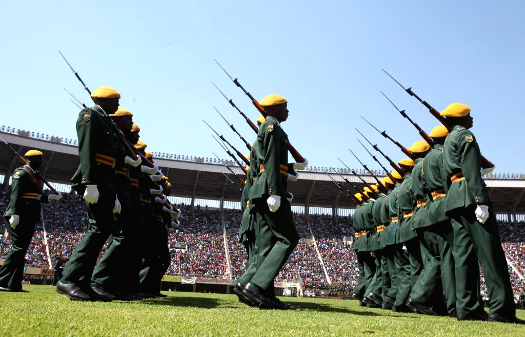 Zimbabwean defense forces take part in a parade at the National Sports Stadium in Harare, Zimbabwe, Aug. 11, 2015. Zimbabwe held the annual Defense Day parade as ...