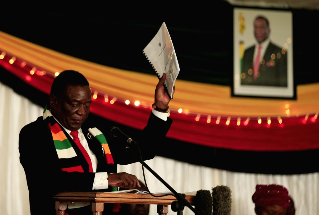 Zimbabwean President Emmerson Mnangagwa addresses the launching ceremony for the country's preparedness and response plan against COVID-19, in Harare, Zimbabwe, ...