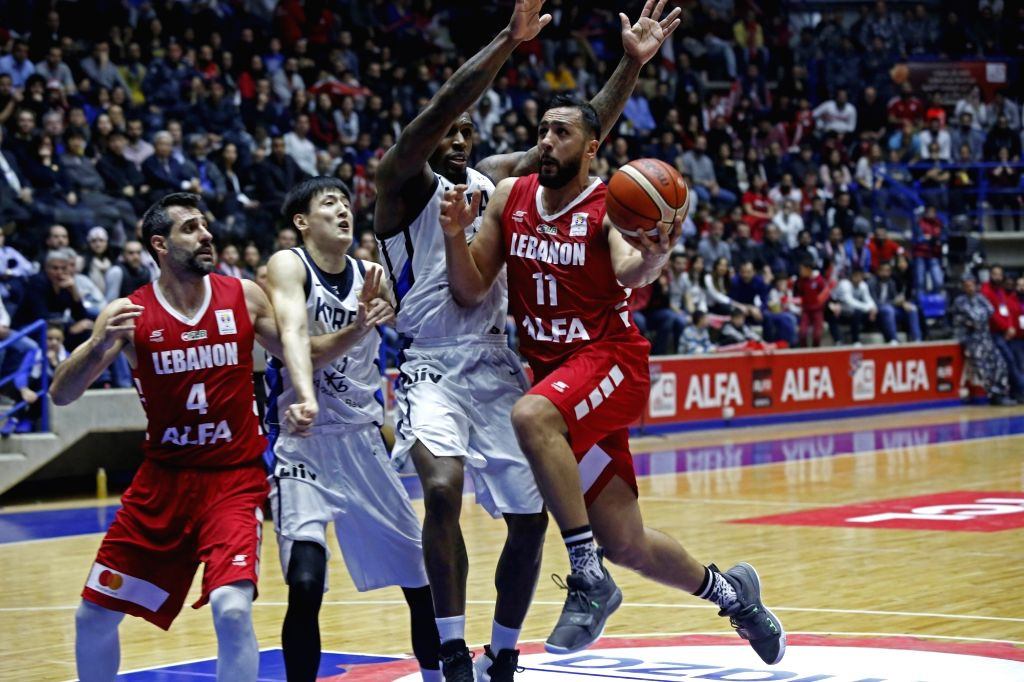 ZOUK MIKAEL, Feb. 25, 2019 - Ali Haidar (1st R) of Lebanon competes during the FIBA Basketball World Cup 2019 Asian Qualifiers match between Lebanon and South Korea in Zouk Mikael, Lebanon, Feb. 24, ...
