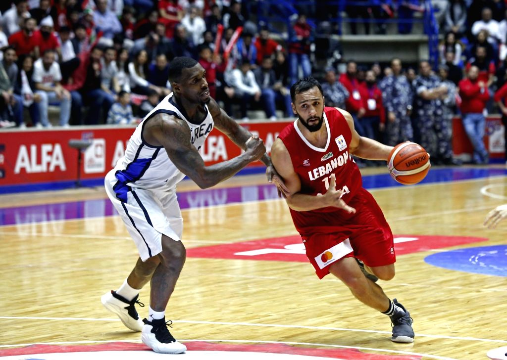 ZOUK MIKAEL, Feb. 25, 2019 - Ali Haidar (R) of Lebanon competes during the FIBA Basketball World Cup 2019 Asian Qualifiers match between Lebanon and South Korea in Zouk Mikael, Lebanon, Feb. 24, ...