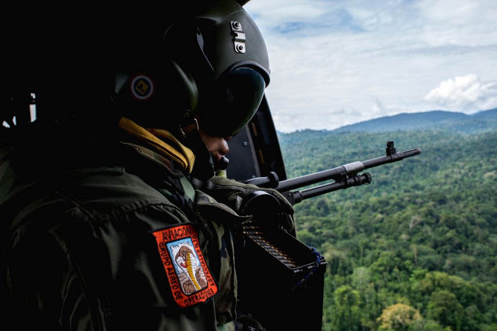 A soldier watches from a helicopter during the Sierra XXIV Operation in the Perija Mountain in Zulia State of Venezuela on Dec. 6, 2014. According to local press, during the operation three ...