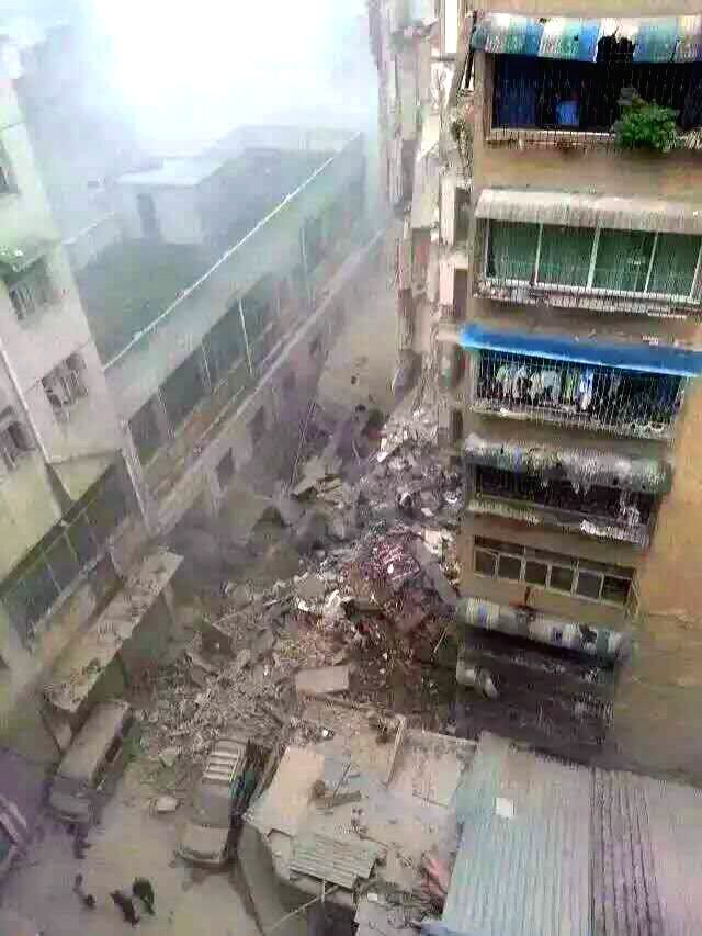 Photo taken with cellphone on June 14, 2015 shows the accident scene where a residential building collapsed in Zunyi City, southwest China's Guizhou Province. Four ...