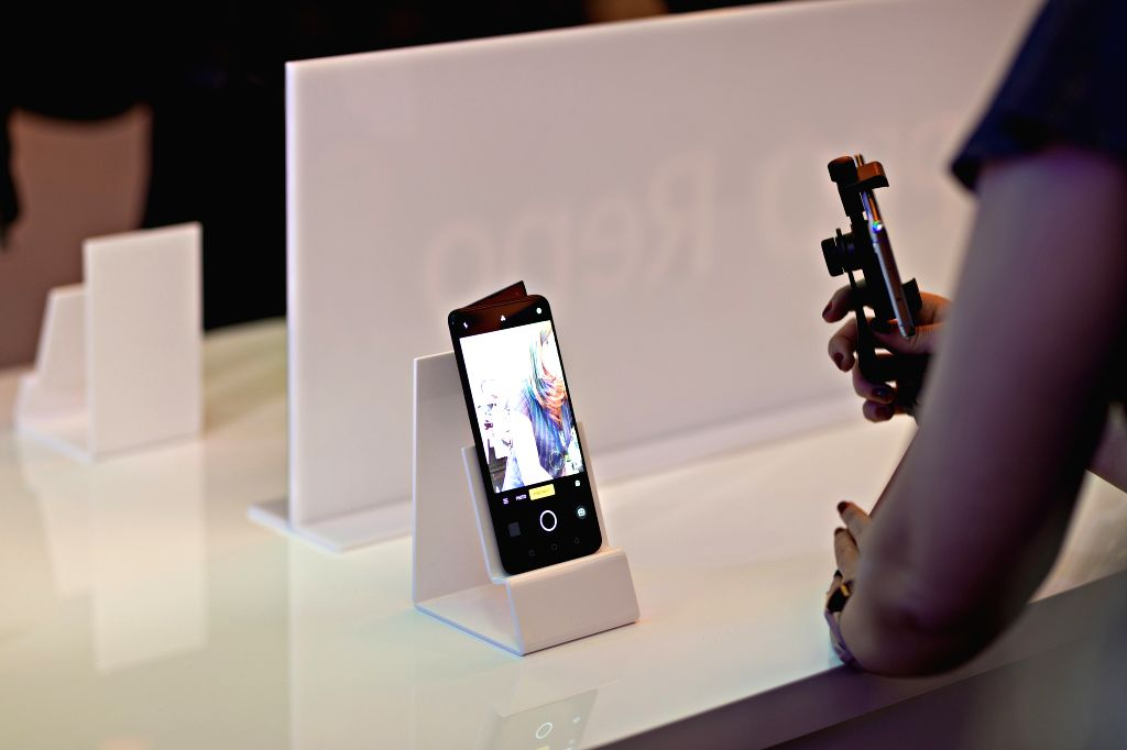 ZURICH, April 24, 2019 - A woman takes pictures of the Oppo Reno 5G smartphone at the launching ceremony in Zurich, Switzerland, April 24, 2019. Together with Switzerland's largest telecom company ...