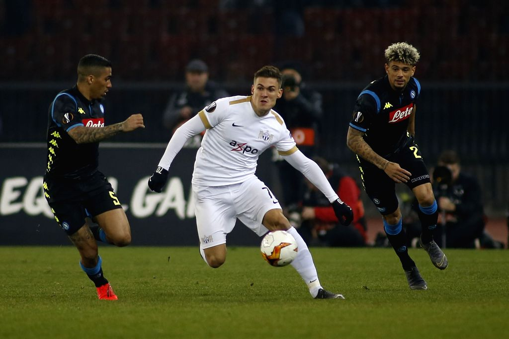 ZURICH, Feb. 15, 2019 - Zurich's Benjamin Kololli (C) vies with Napoli's Allan (L) and Kevin Malcuit during the UEFA Europa League round of 32 first leg soccer match between Switzerland's FC Zurich ...