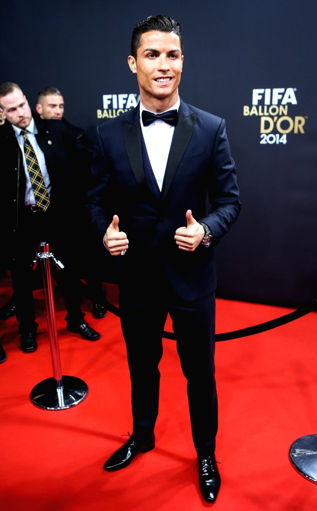 Cristiano Ronaldo of Portugal poses on the red carpet ahead of the 2014 FIFA Ballon d`Or award ceremony in Zurich, Switzerland, Jan. 12, 2015.