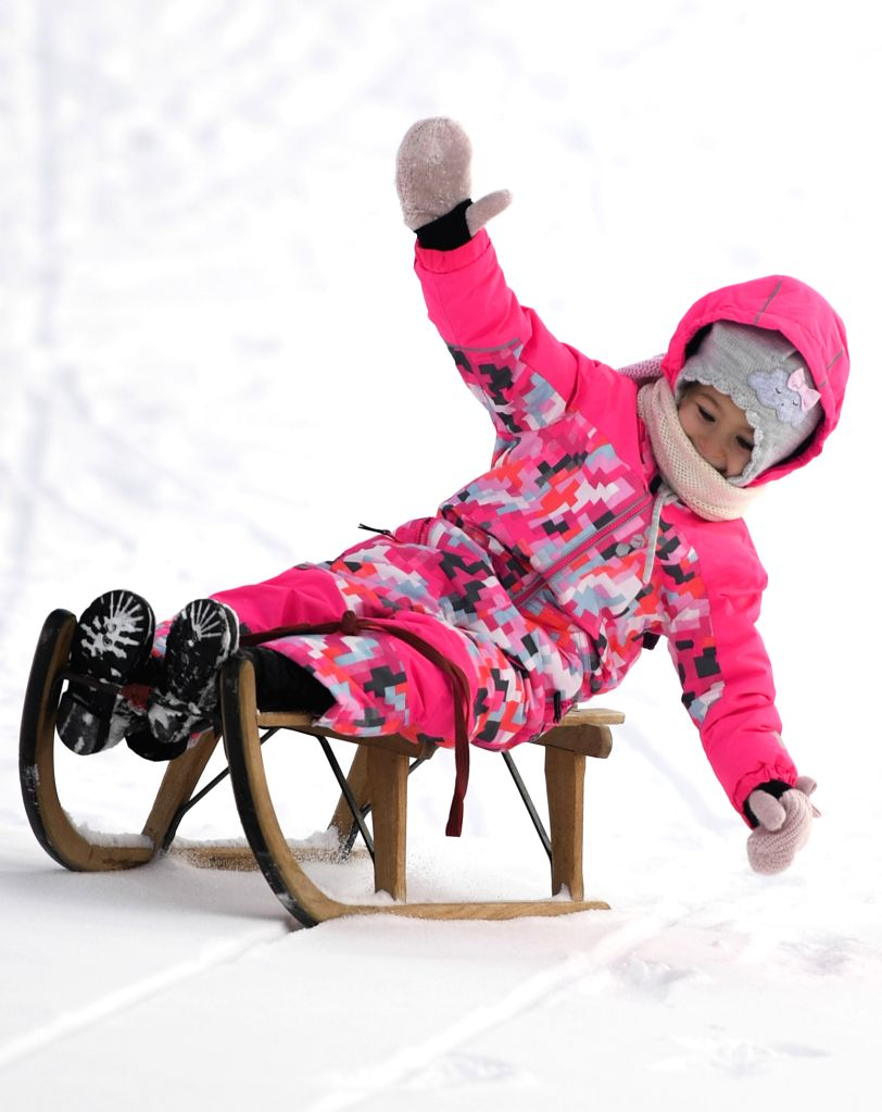 ZURICH, Jan. 13, 2017 - A girl plays on a sled in the snow in Davos, Switzerland, Jan. 12, 2017.