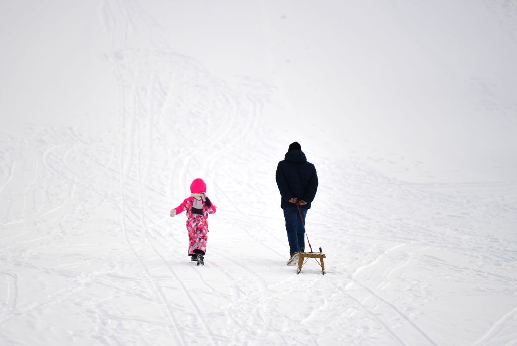 ZURICH, Jan. 13, 2017 - A man and his daughter walk on the snow-covered slope in Davos, Switzerland, Jan. 12, 2017.