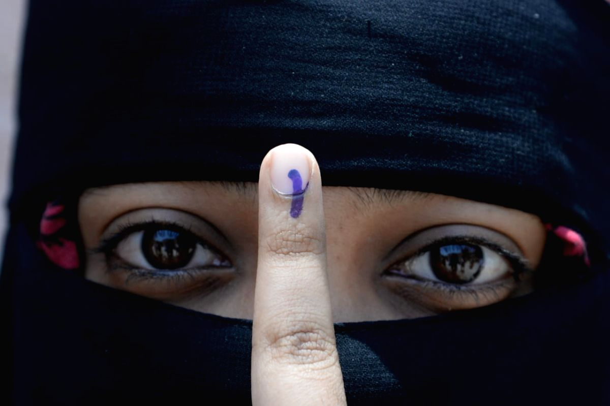 A first time voter shows her inked finger after casting her vote .