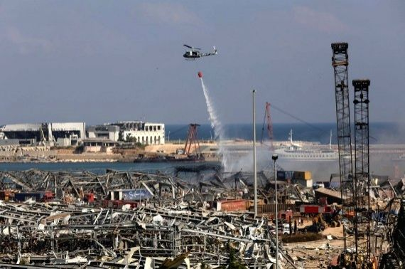 A helicopter sprays water to extinguish fire after the explosions at the Port of Beirut in Lebanon (IANS/Xinhua)