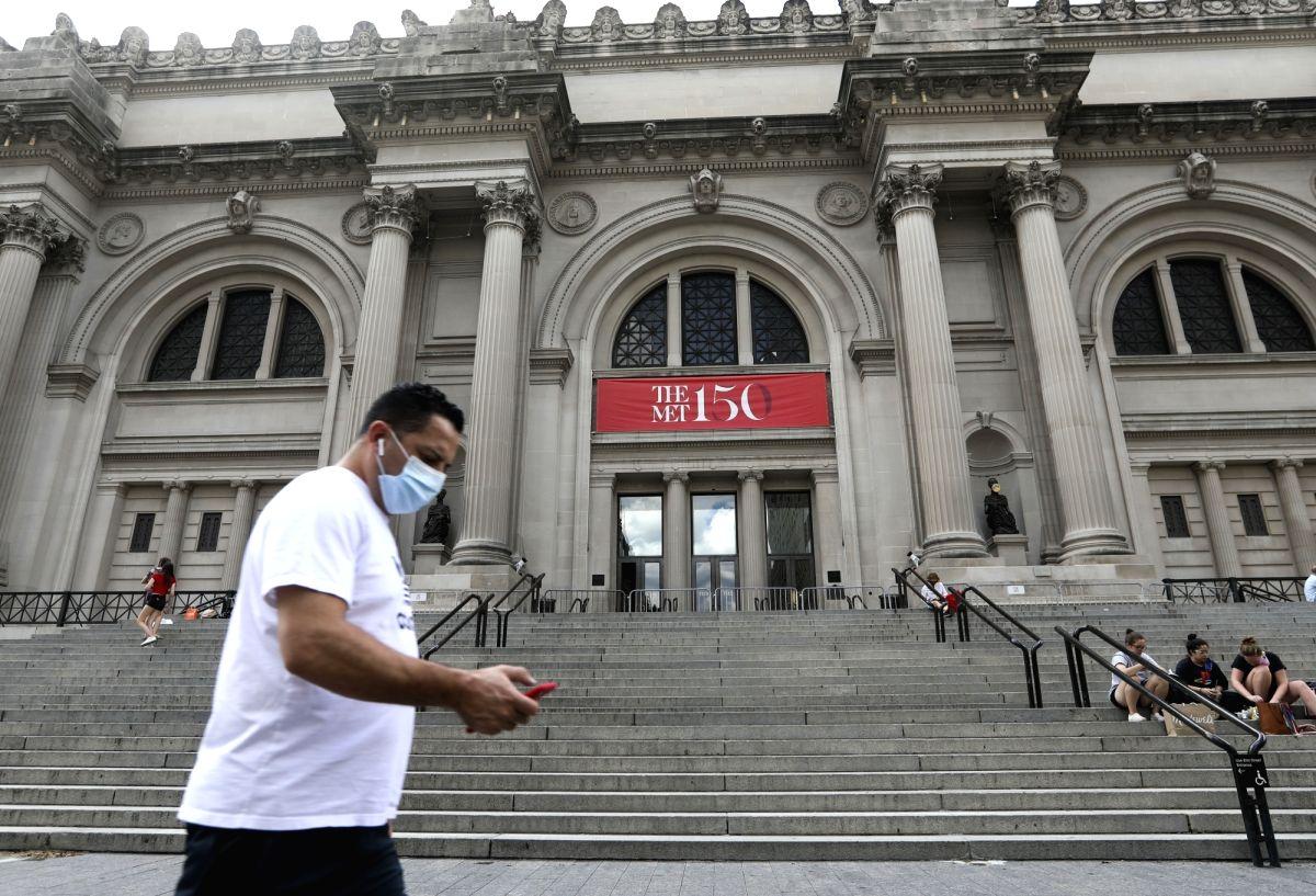 A pedestrian walks past the Metropolitan Museum of Art in New York